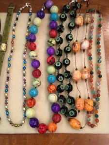 Pearl-knotted necklaces